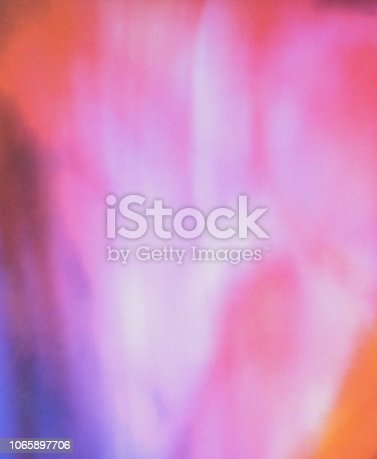 istock Defocused Blurred Motion Abstract Background Purple Red 1065897706