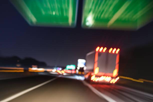 Defocused blurred motion of semitruck speeding on highway road speedway - foto de acervo
