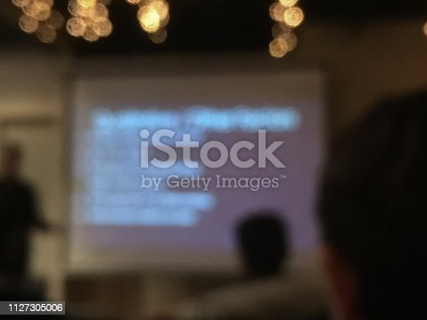 508658652istockphoto Defocused blurry scene of AI Fintech coding tutoring session in a classroom 1127305006