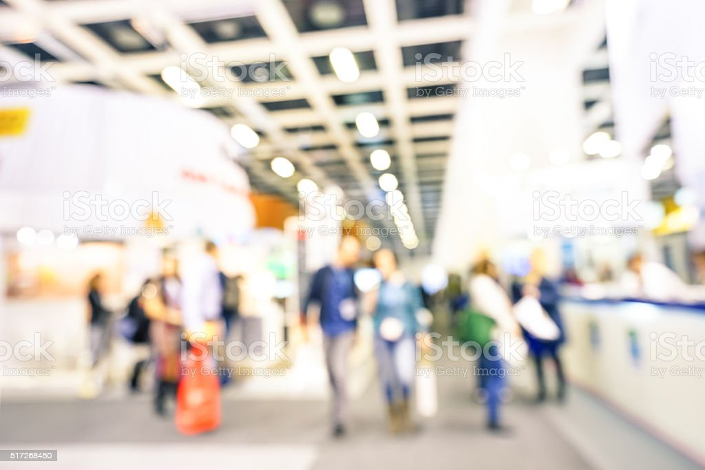 Defocused bokeh abstract of generic trade show expo stand booth stock photo