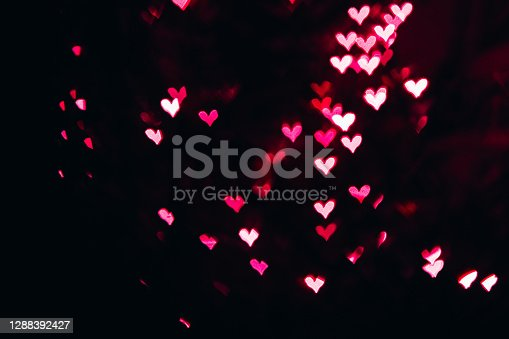 Bokeh lights in shape of Pink kand red hearts. Background for blend mode.