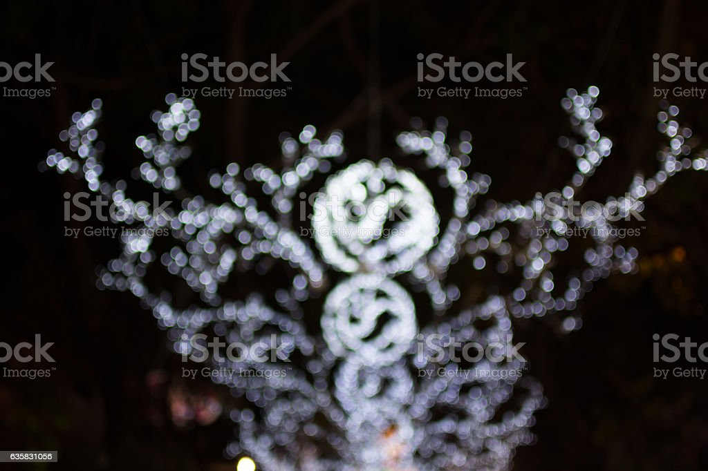Defocused bokeh lights of Christmas day background. stock photo
