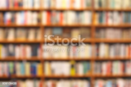 istock Defocused bookstore background, shelves with books 509109438