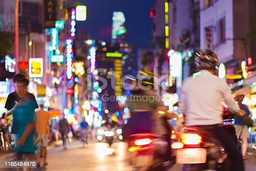 istock Defocused busy night street with neon lights - Ho Chi Minh City (Saigon), Vietnam 1165484970
