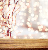 Defocused Christmas light and wooden background