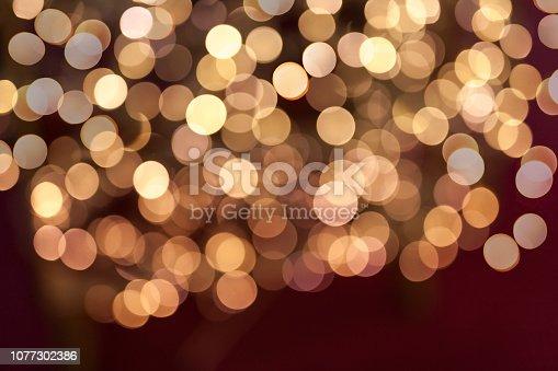 857847778 istock photo Defocused Christmas Lights Background 1077302386