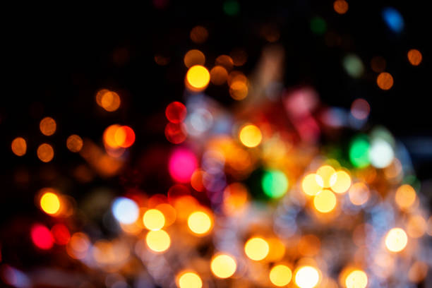 Defocused Christmas lights backgrounds Defocused Christmas lights backgrounds illuminated stock pictures, royalty-free photos & images