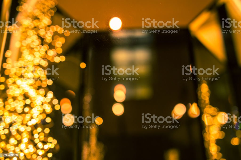 defocused christmas lights in shop exposition royalty free stock photo
