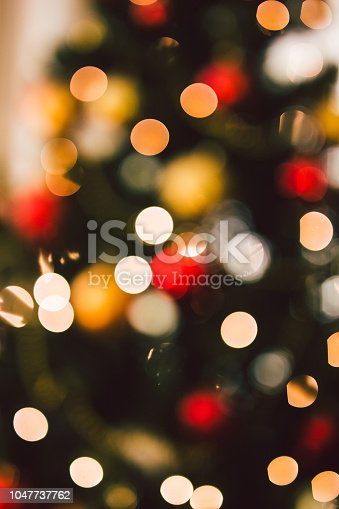 istock Defocused Christmas tree lights 1047737762