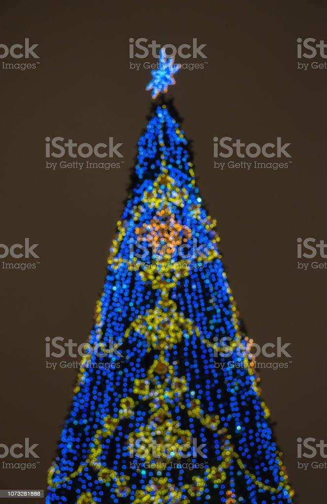Defocused christmas tree silhouette stock photo