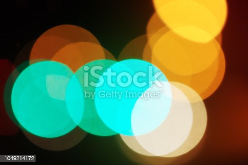 istock Defocused circles of  overlapping lights as a background 1049214172