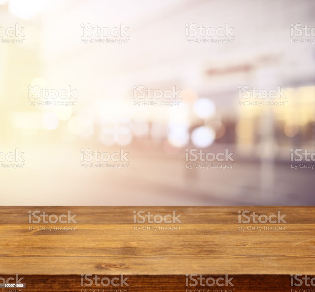 defocused city lights and wooden background stock photo
