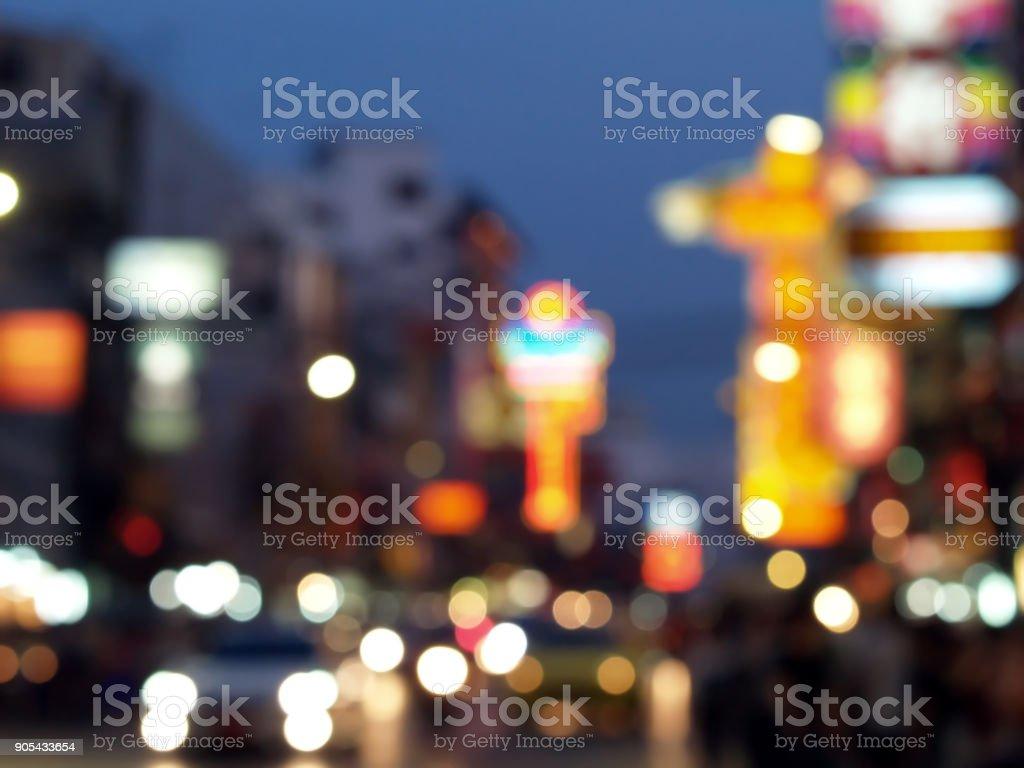 blurred city life at night of Chinatown, Thailand