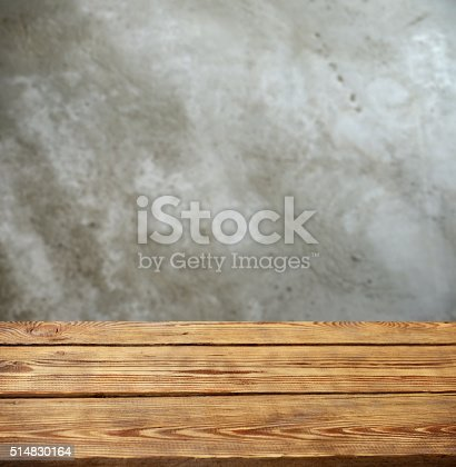 Defocused concrete background and a wooden background