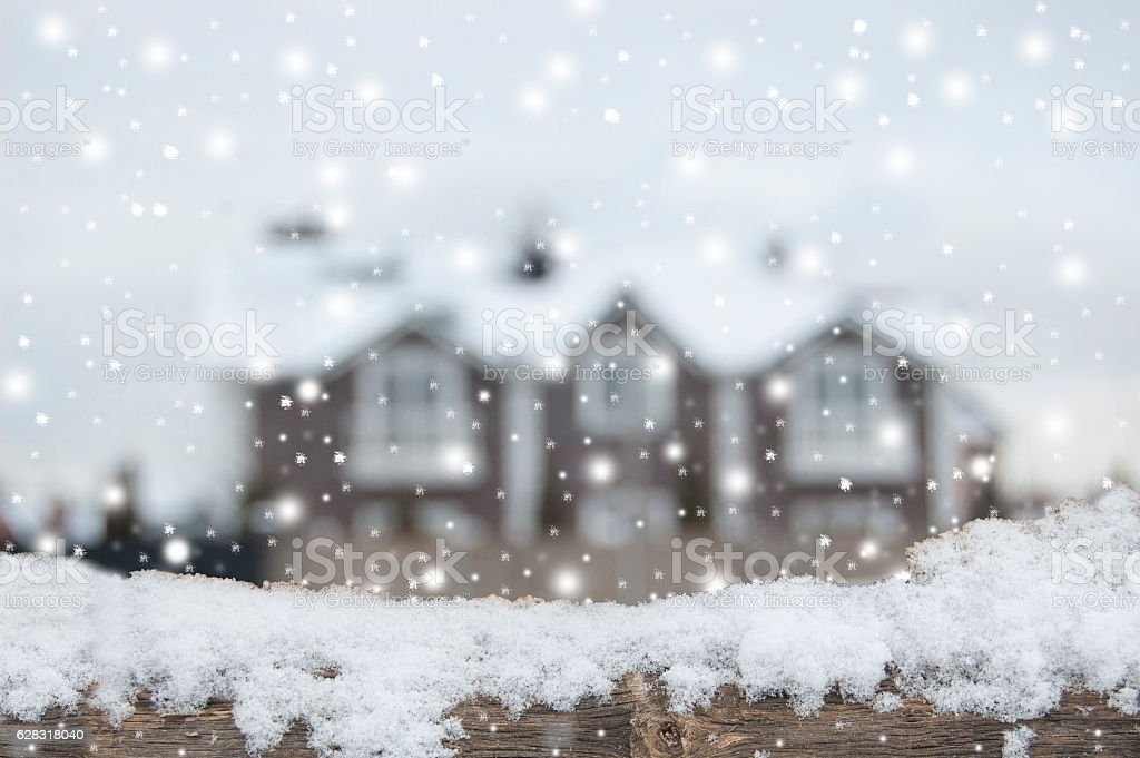 Defocused country house with car and fence in snow. stock photo