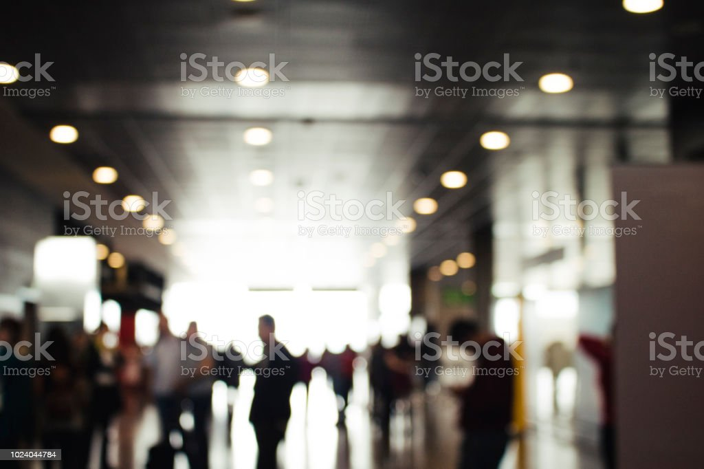 Anonymous people in a modern building with a monochromatic futuristic...