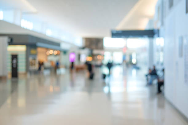 defocused empty airport terminal background - green screen background stock photos and pictures