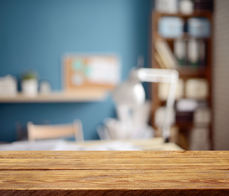 istock Defocused empty office interior and a wooden background 526552300