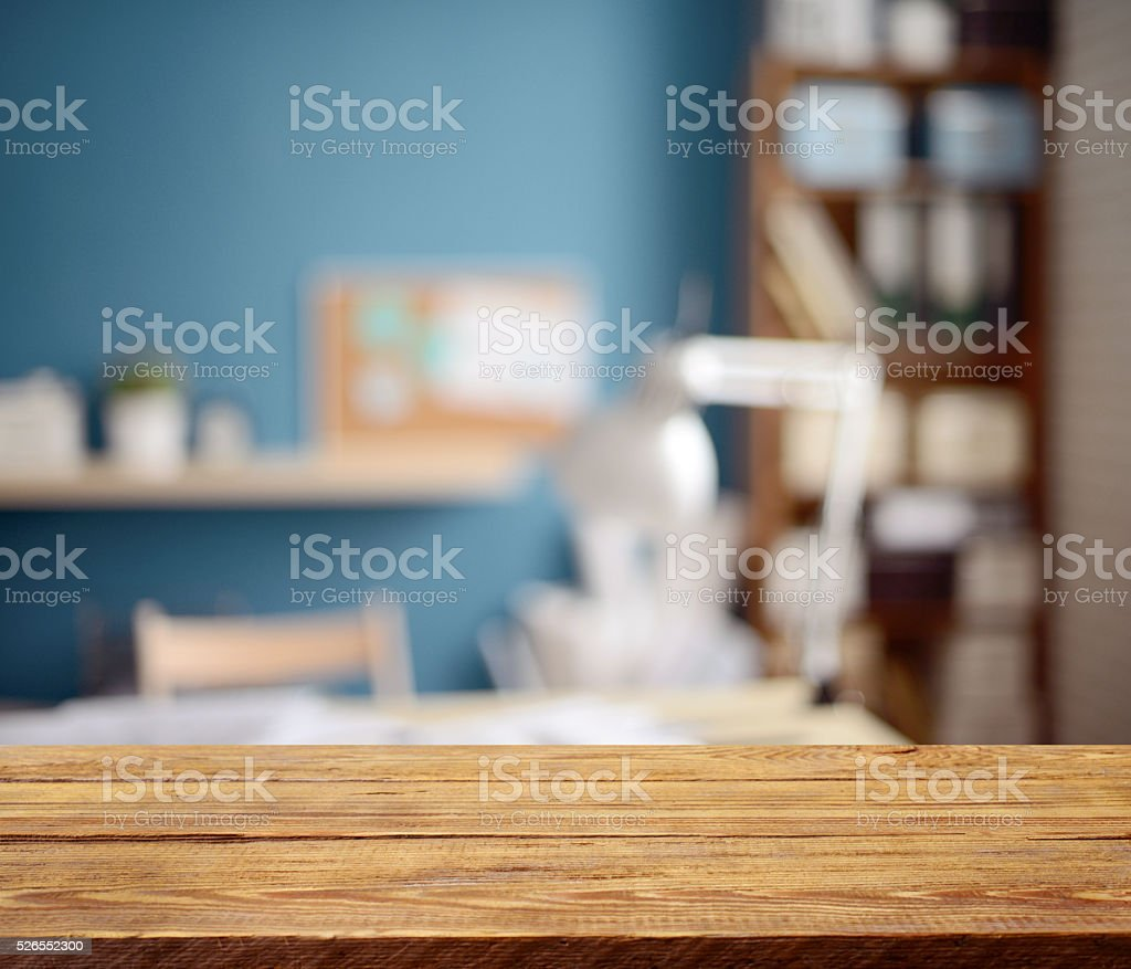 Defocused empty office interior and a wooden background stock photo