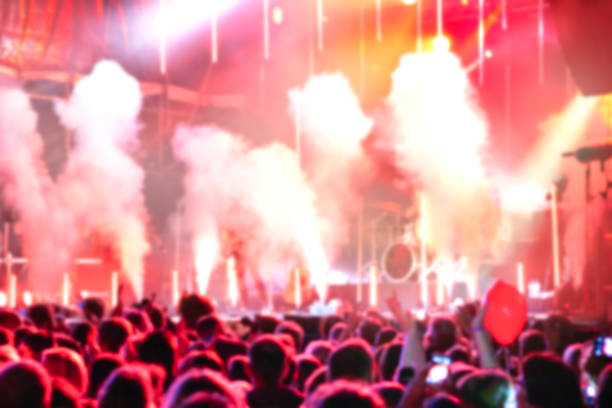 Defocused entertainment concert on stage Open Air concert in Hamburg - Germany pyrotechnic effects stock pictures, royalty-free photos & images