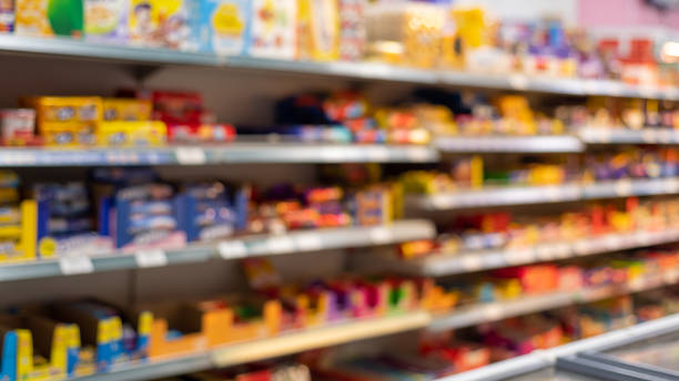 Defocused food store shelf with pre-packaged food stock photo