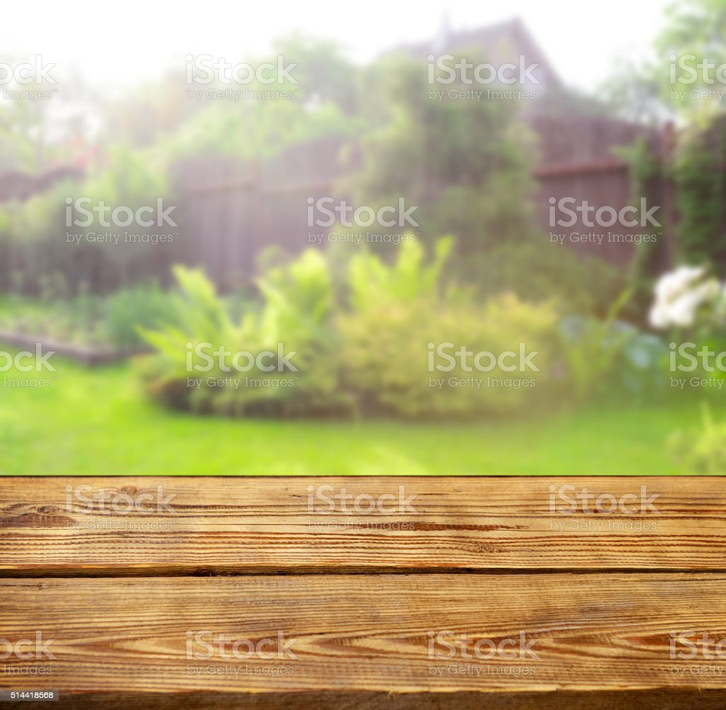 Defocused garden and wooden background stock photo