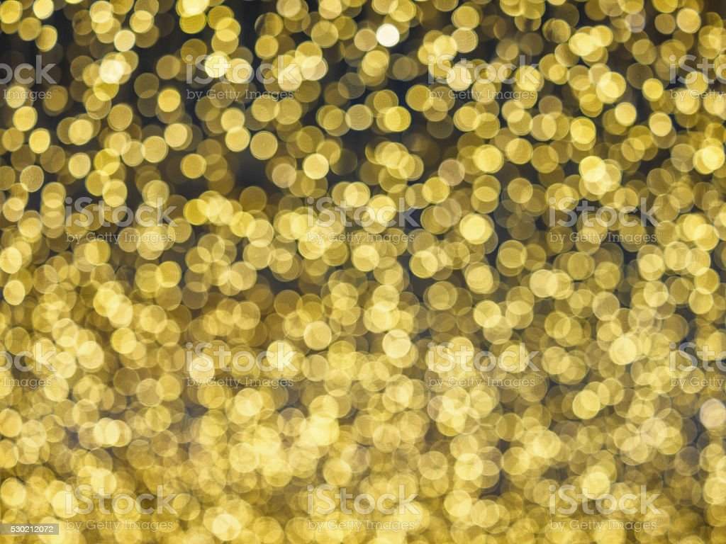 Defocused gold abstract christmas background stock photo