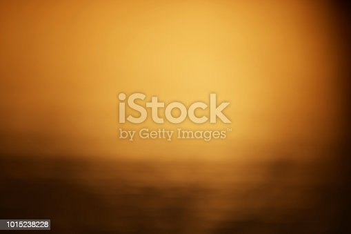 horizontal shot of defocused gold background in sunset time.