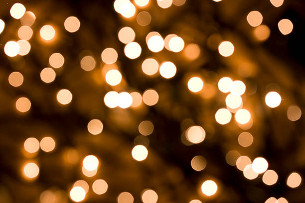 defocused gold lights - christmas lights stockfoto's en -beelden