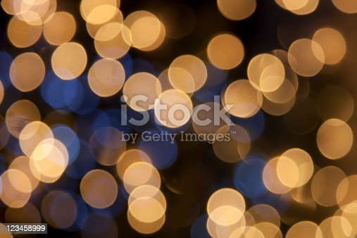 istock defocused golden light dots against black background 123458999