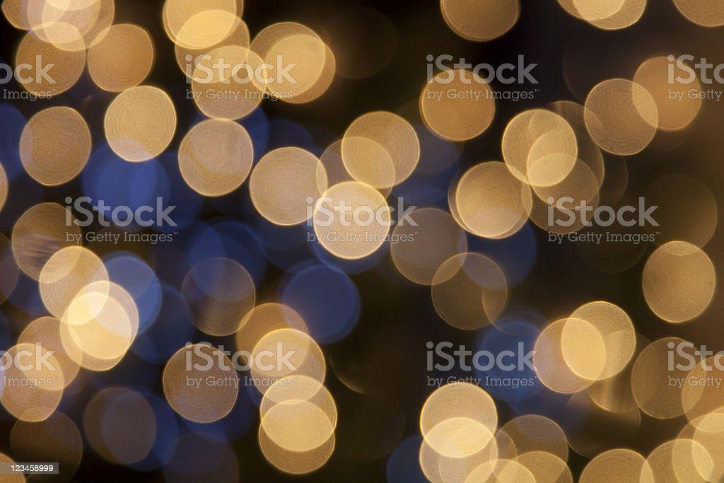デフォーカスゴールドの明るいドットとブラックの背景 ストックフォト