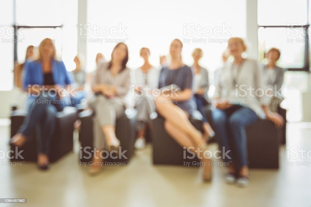 Defocused group of women at seminar Abstract blurred photo background of business women in a seminar room. Defocused group of women attending training. Adult Stock Photo