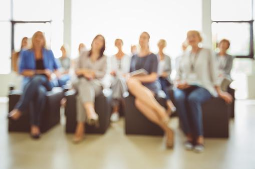 Defocused Group Of Women At Seminar Stock Photo - Download Image Now