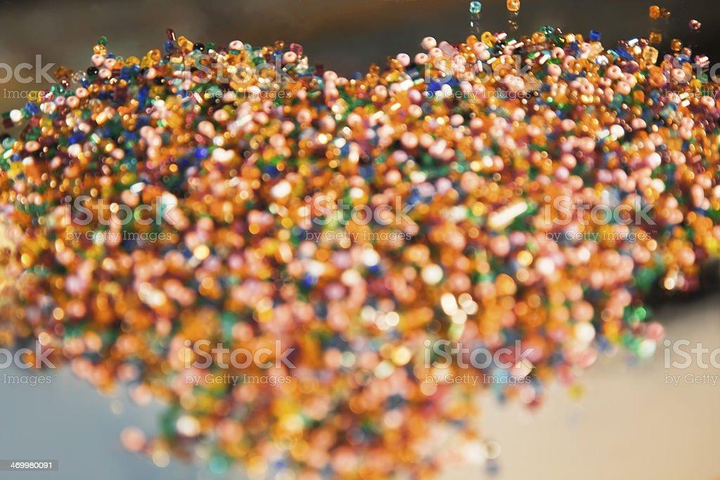 Defocused illuminated colorful glittering glass beads background. royalty-free stock photo