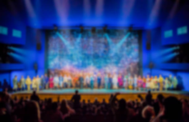 Defocused image. Auditorium in the theater during the performance. The scenery on the stage