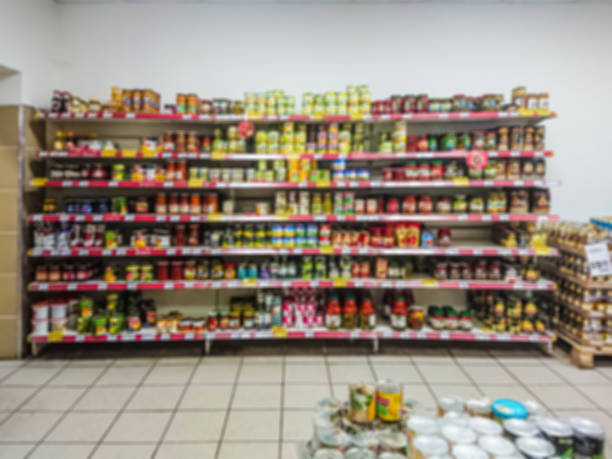 Defocused image. Canned vegetables on the shelves of a grocery supermarket