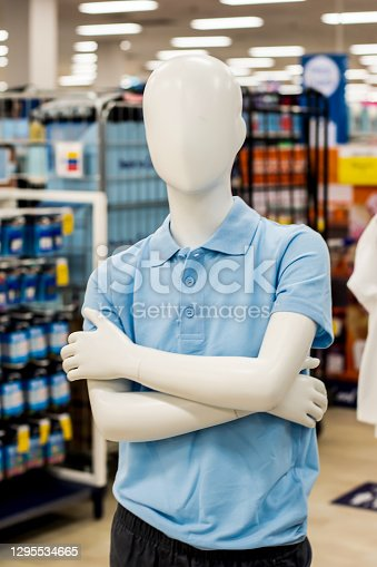 Blurred image of a mannequin dressed in blue boys school uniform at department store. Back to school shopping.