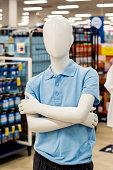 istock Defocused image of a mannequin dressed in blue boys school uniform at department store. 1295534665