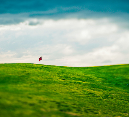 Defocused Image Of Golf Course Background With Red Flag Stock Photo Download Image Now Istock