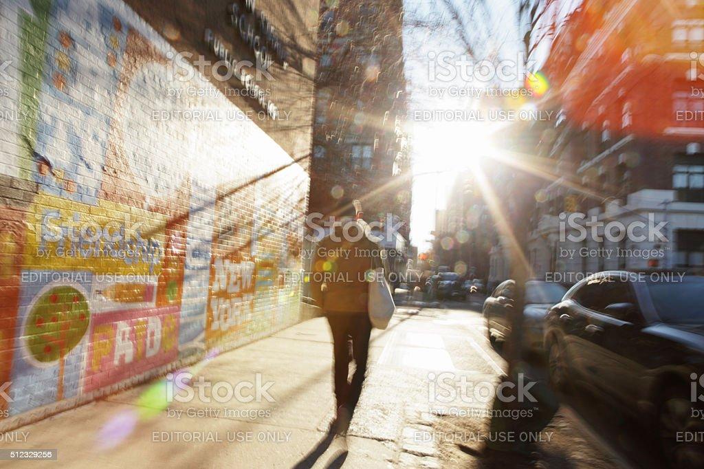 Defocused image of sun rising down NYC backstreet stock photo