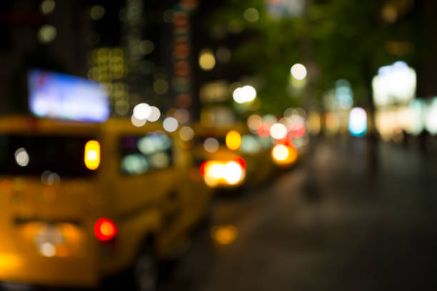Defocused image of yellow taxi in New York City at night stock photo