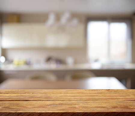 Defocused interior and wooden background
