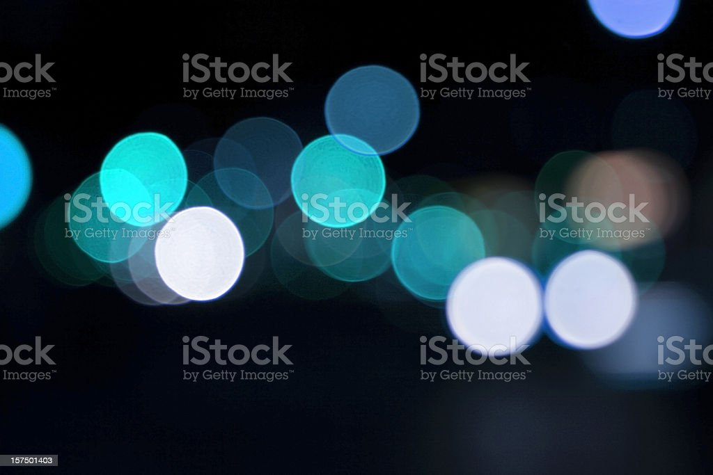 defocused light dots against black background royalty-free stock photo