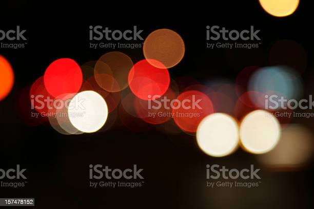 Defocused Light Dots At Manhattan Traffic In Twilight Stock Photo - Download Image Now