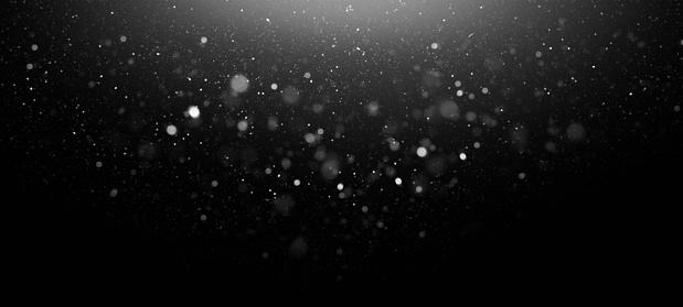 Defocused White Lights Over Dark Background