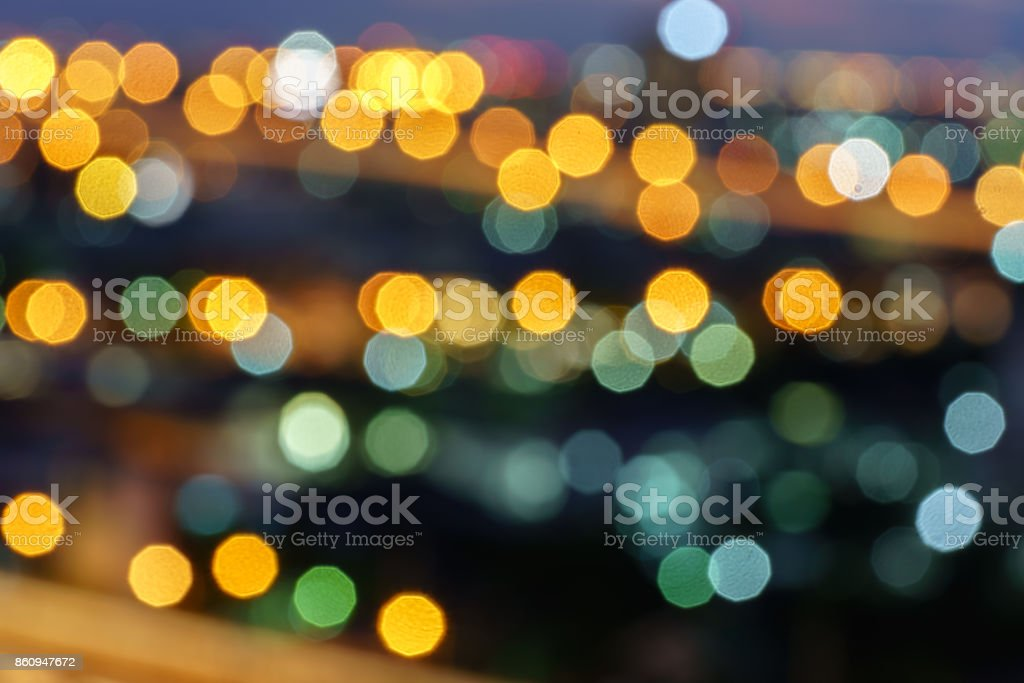 Defocused lights abstract colorful nonagon bokeh background stock photo