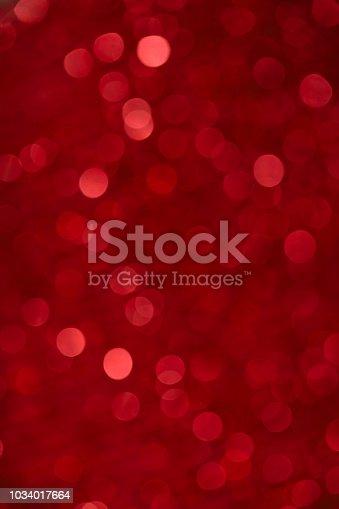 Defocused lights background in red tones.