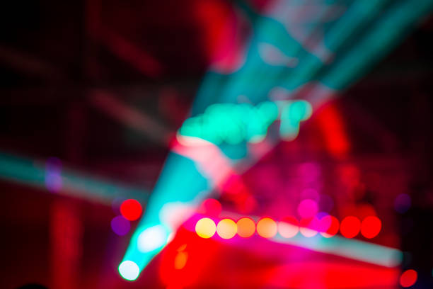 defocused lights on concert stage - disco lights stock photos and pictures