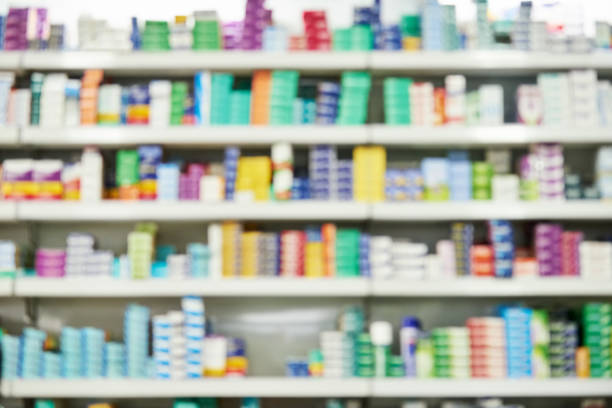 Defocused medicine store background Blurred background shot of a pharmacy store rack with medicines generic description stock pictures, royalty-free photos & images