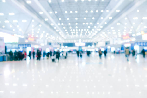defocused modern airport hallway - airport terminal stock photos and pictures